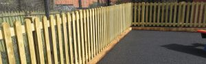 Wooden fencing around a school play area
