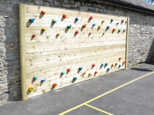 Wooden traversing climbing wall in a playground