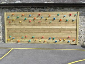 Wooden traversing climbing wall for children