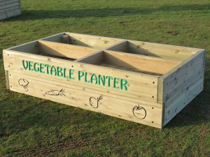 Wooden vegetable planter at a school