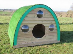 Woodland play pod with port hole windows
