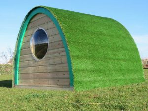 Woodland play pod with grass roof