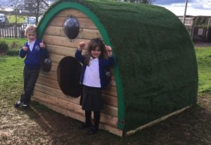 Kids play in the wooden Play Pod