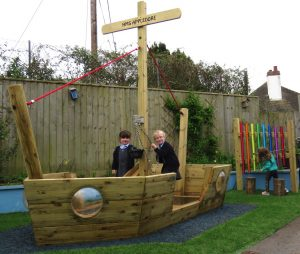 A wooden play boat in the school play area