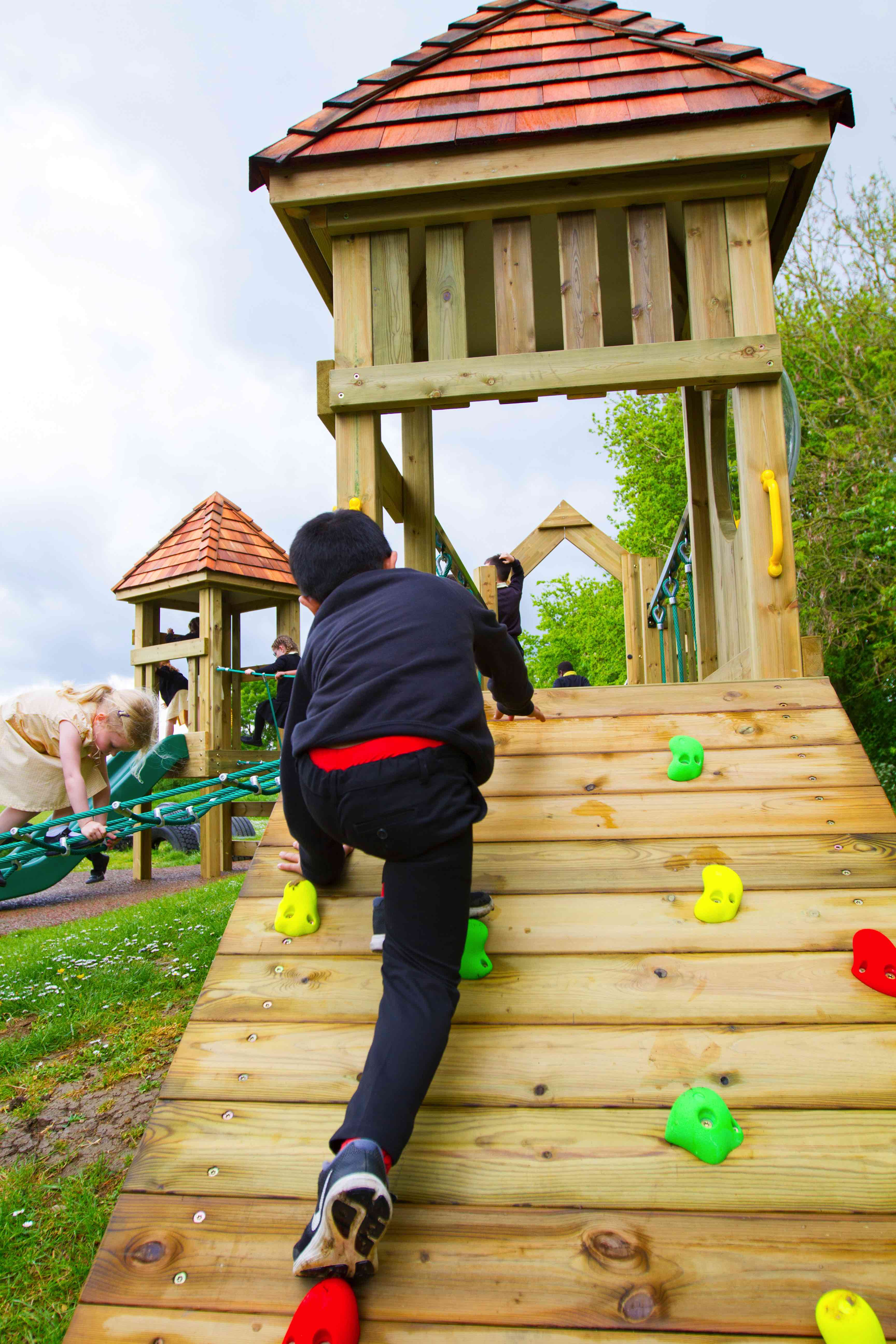 Every childs play area needs the wooden ramp climber !