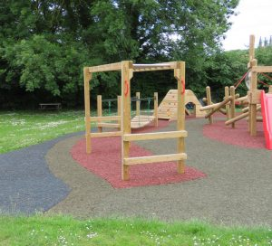 Wooden monkey bars over safet surfacing