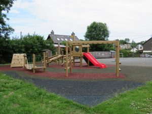 Play equipment installed over safety surfacing
