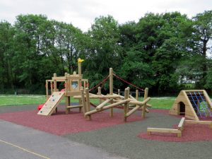 Outdoor play equipment on safety surfacing