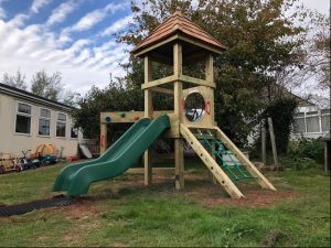 A wooden play tower for children
