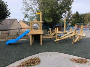 Wooden play tower with slide