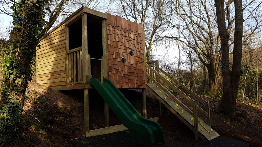 Wooden playhouse den at local school