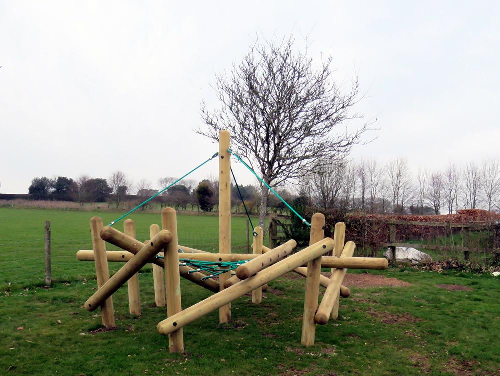 A wooden pole climber