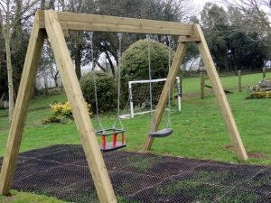 A traditional wooden swing in the play area