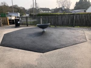 Playground equipment repairs including safety surfacing