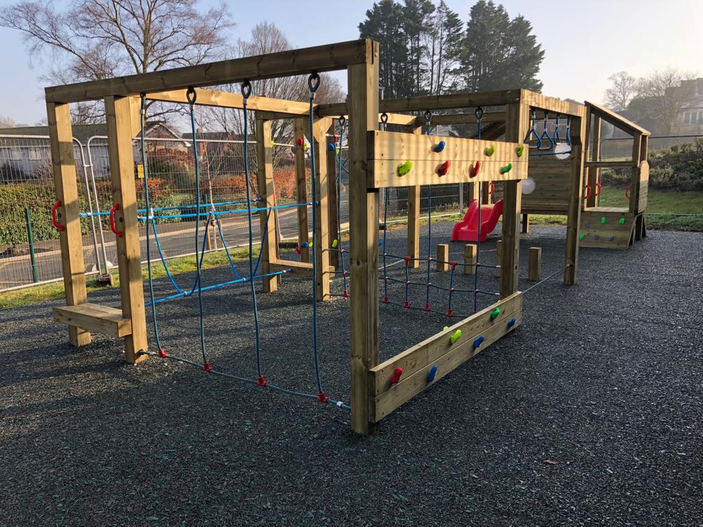 Timber play equipment of safety surfacing