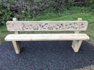 Front view of an engraved wooden bench