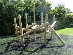 A playground pole climber on safety flooring
