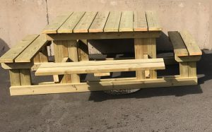 A sturdy wooden picnic bench