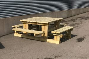 A large wooden picnic bench with table