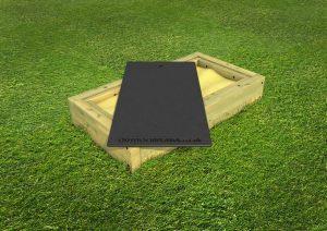 Small wood framed sand pit for children
