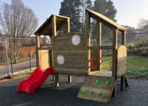 A wood built play tower for toddlers