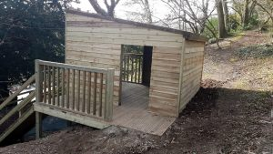 Side view of the woodland play hut for kids