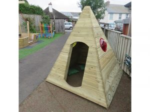 A wooden tepee in school playground