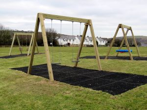 Traditional wooden swing set for children