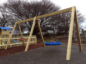 Traditional wooden swing set for toddlers