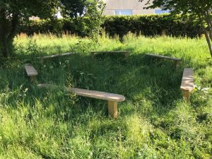 Wooden becnh seating for school play areas