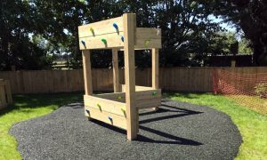 Wooden traversing wall for childrens outdoor play time