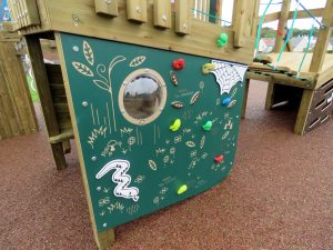 Wooden play equipment installed outdoors at a school