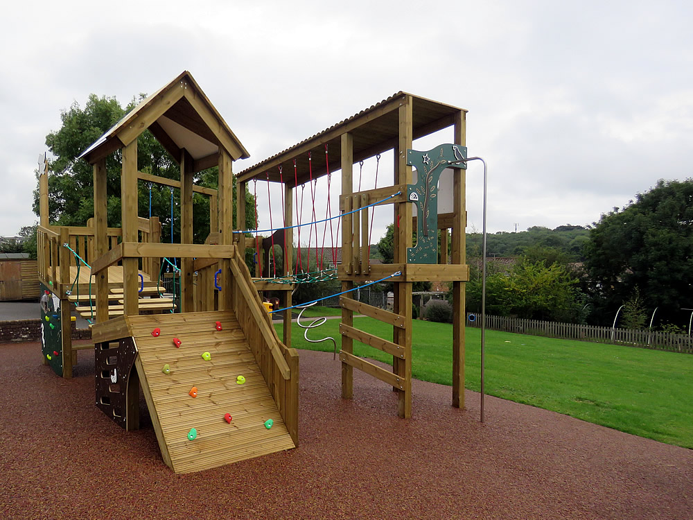 Play equipment on safety surfacing