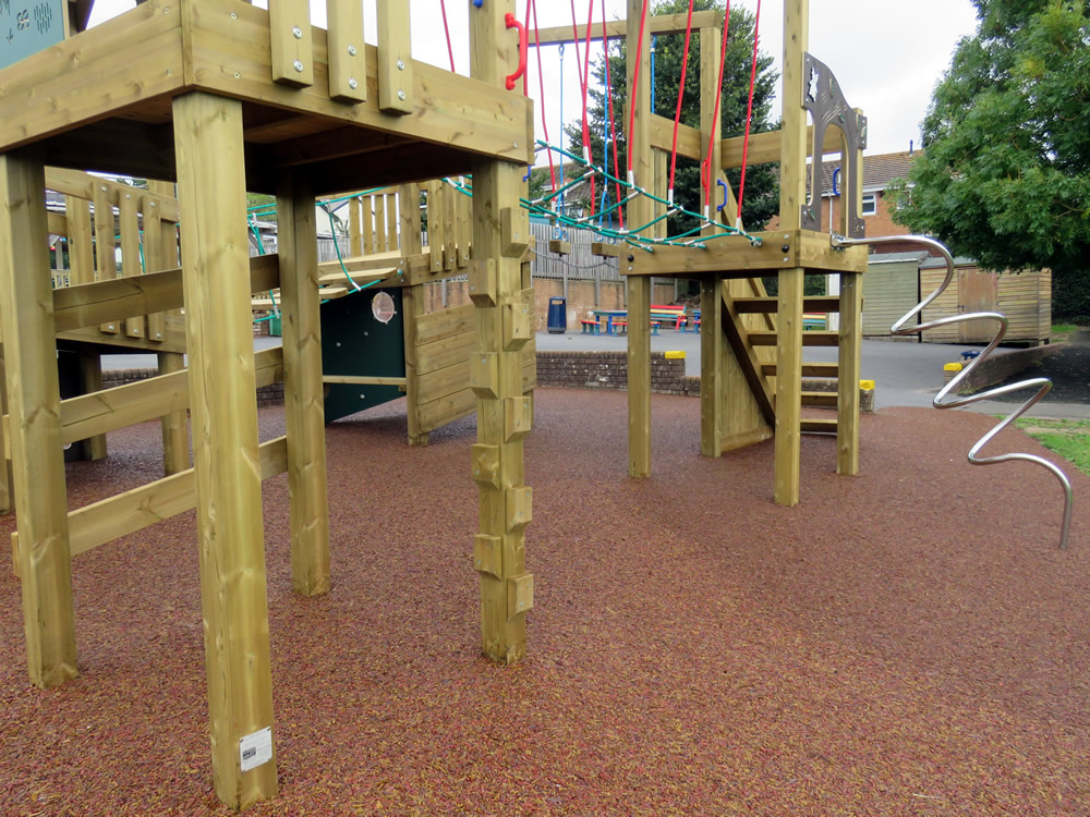 Childrens wooden play towers in playground