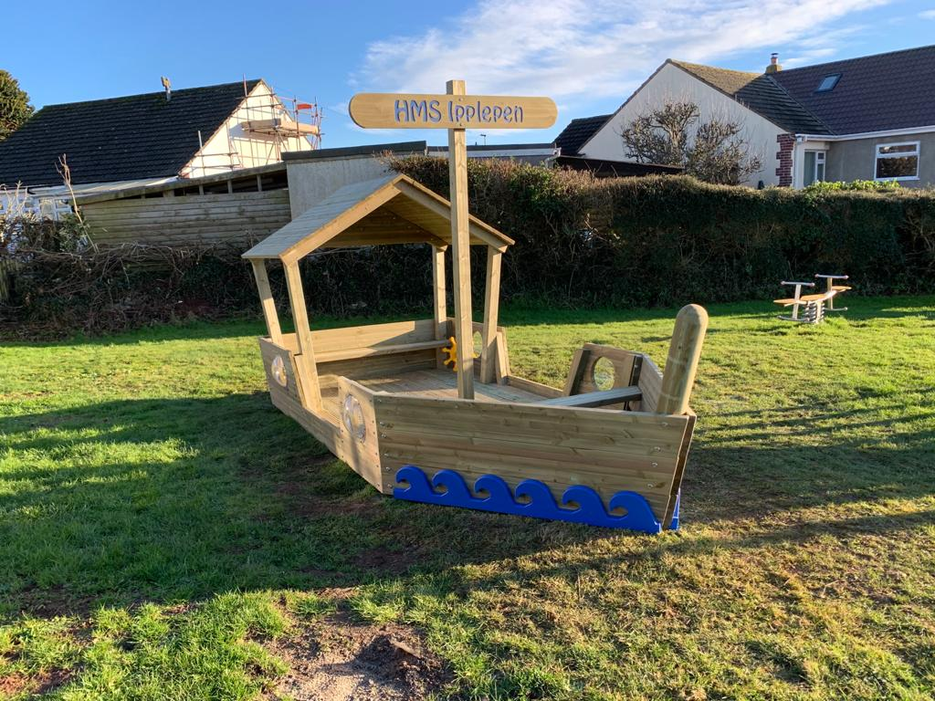 An outdoor play boat in a play park