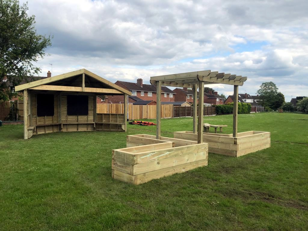 Wooden shelters for outdoor learning in school field